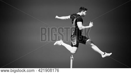 Composition of male hurdle jumper with copy space in black and white. sport and competition concept digitally generated image.