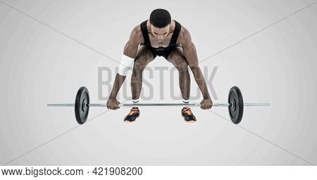 Composition of african american male weightlifter with barbell on grey background. sports and competition concept digitally generated image.