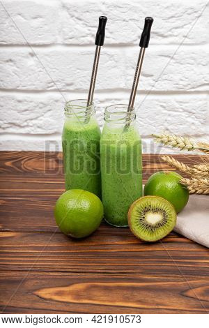 Freshly Blended Green Fruit Smoothie In Glass Jar With Straw. Healthy Smoothie. Glasses With Green O