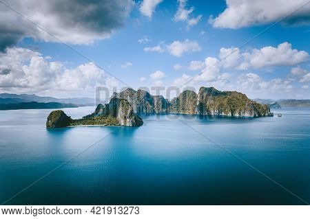 El Nido, Palawan, Philippines. Panoramic Aerial View Lonely Tourist Boat In Open Sea With Exotic Tro