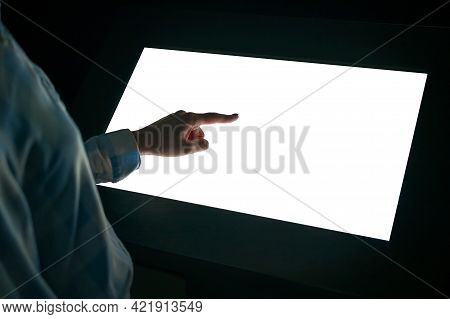 Woman Hand Using White Blank Interactive Touchscreen Display Of Electronic Multimedia Kiosk In Dark