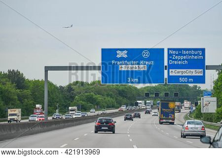 Germany - August 2015: Traffic On The Autobahn, Direction Signs, Distances To Cities. Cars On The Tr