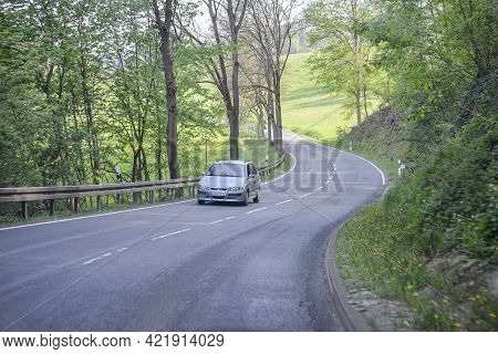 Germany - August 2015:view From The Car Window. The Road Among The Green Forest, Cars On The Autobah