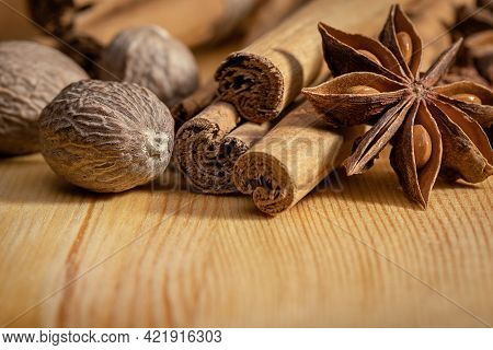 A Set Of Spices For Cooking, Nutmeg, Anise And Cinnamon Sticks. Indian Cuisine, Copy Space.