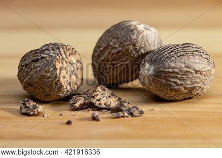 Nutmeg Isolated. Whole Nuts And Nutmeg Powder Isolated On White Background