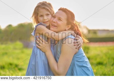 Nature Scene With Family Outdoor Lifestyle. Mother And Little Daughter Playing Together In A Park. H
