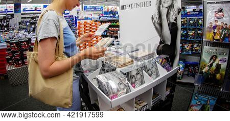 Germany - May 26, 2017: Happy Woman Choosing The Latest Cd Single From The Renown Helene Fischer Sin