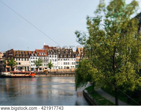 Tilt-shift View Of Main Street In Strasbourg With Timbered Houses And Ill River