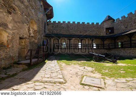 Stara Lubovna, Slovakia - 28 Aug 2016: Ancient Cannon In The Inner Courtyard Of The Castle. Great St