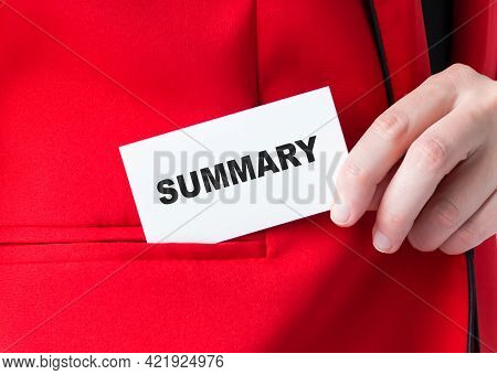 Summary Word On The Card In The Hands Of A Woman Who Puts A Card With Writing In Her Pocket