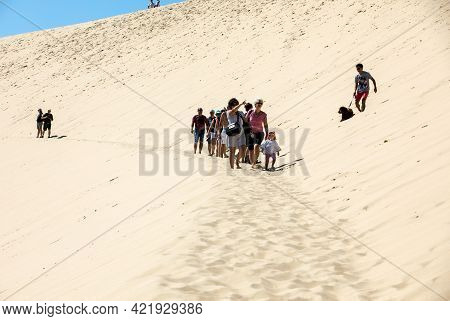 Dune Of Pilat, France - September 10,2018: People Walking On The Top Of The Dune Of Pilat, The Talle