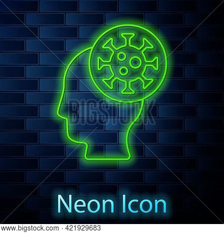 Glowing Neon Line Human And Virus Icon Isolated On Brick Wall Background. Corona Virus 2019-ncov. Ba