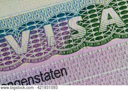 Schengen European Visa Stamp In The Passport. Clouse-up. Fragment Of Schengen Visa In The Passport