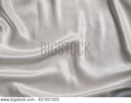 White Satin Background With Folds And Shadows. Light Shiny Rippled Silk Texture Website Advertisemen