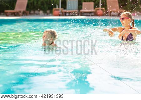 Happy Kids Having Fun At The Pool