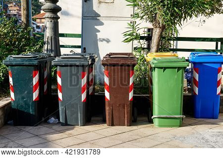 Recycling Bins Of Different Colors On The Street To Protect The Environment. Color Of The Bin For Di