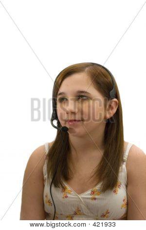 Teenage Girl Talking On Headset Phone.