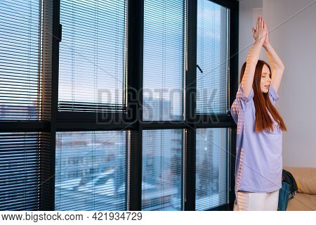 Side View Of Happy Peaceful Redhead Young Woman Practicing Yoga, Standing In Vrksasana, Tree Pose St