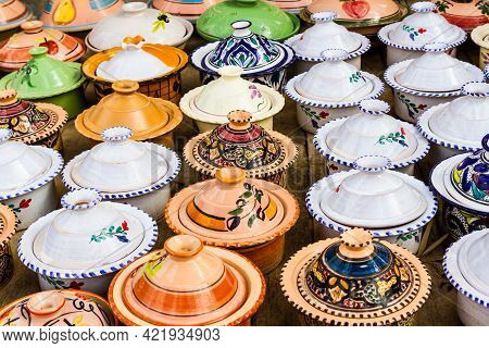 Colorful Ceramic Tagines For Sale. Typical Traditional Moroccan Ceramic Tagines In A Gift Store. Mor