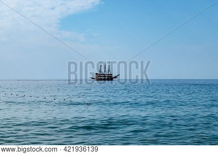 Single Pirate Schooner Among Blue Water Off The Coast Of Alanya (turkey). One Tourist Ship On The Ho