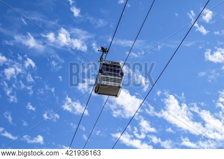 Cable Car Cabin Isolated On Blue Cloudy Sky Background - Bottom View. Funicular Railway In Alanya (t