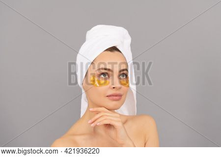 Sensual Lady With Terry Towel Use Facial Golden Eye Patch For Skin, Hydrogel
