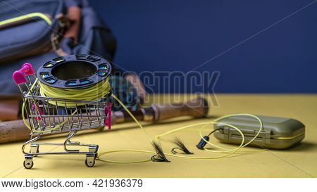 Fishing Rod, Fly Box, Fly Fishing Reel With Line In Mini Cart. Fly Fishing Shopping Concept.