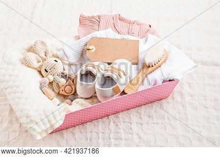 Gift Basket With Gender Neutral Baby Garment And Accessories. Care Box Of Organic Newborn Cotton Clo