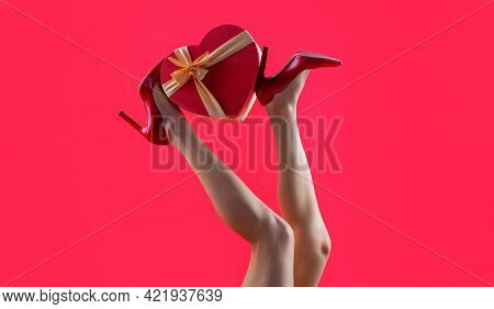 High Heel Shoes. Gift In Heart Shape On The Background. Gift Tied With Ribbon. Valentines Day. Beaut