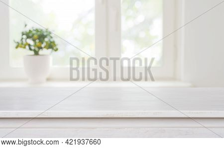 Bleached Wooden Table On Blurred Window Background With Copy Space