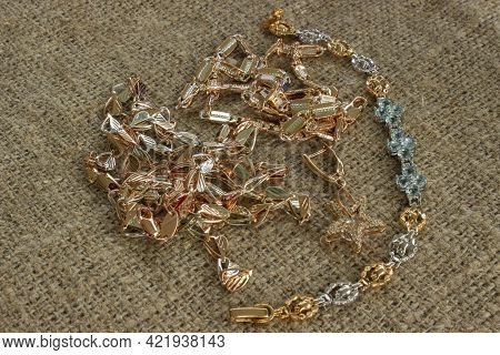 Metal Chains For Decorating Bags And Clothes. Decorative Chains On A White Background. Gold, Silver