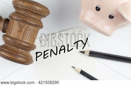 Penalty Text On Paper With Gavel And Piggi Bank, Business