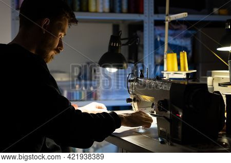 Hipster Clothes Designer Man Sew At Sewing Machine. Design Work In Tailoring Studio Concept. Male Ta