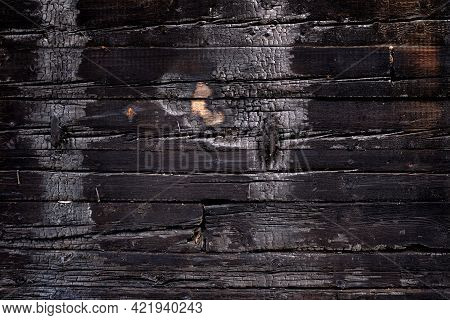 Burnt Wooden Board Texture. Burned Scratched Hardwood Surface. Charred Board