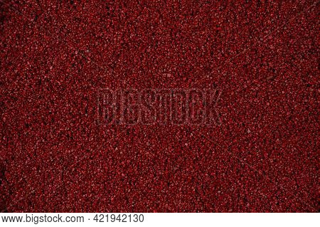 Background Image Of Sand And Pebbles Close-up. Red Pebbles And Grains Of Sand. Colored Sand For Desi