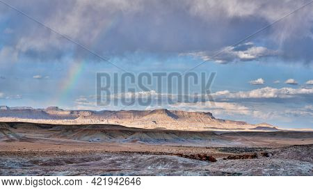 arid desert landscape with a rainbow in Utah near town of Green RIver