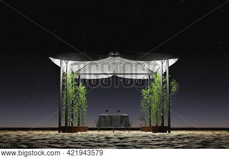 Gazebo With Romantic Dinner On The Beach With Plants And Light Bulbs Illuminating On A Starry Night.