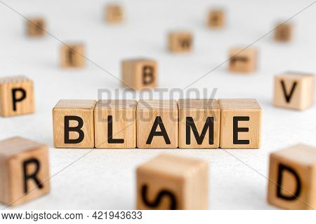 Blame - Word From Wooden Blocks With Letters, Blame, Fault, Guilt, Concept, Random Letters Around Wh