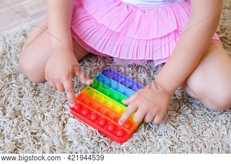 Colorful Antistress Sensory Toy Fidget Push Pop It In Kids Hands. Kids Play With Pop It Sensory Toy.