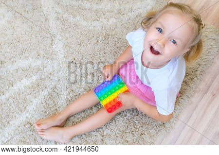 Child Plays With A Flapping Fidget. Popular Childrens Flexible Sensory Toy Develops Fine Motor Skill