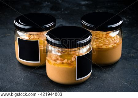 Classic Hummus With In A Glass Jar. Traditional Middle Eastern Cuisine.