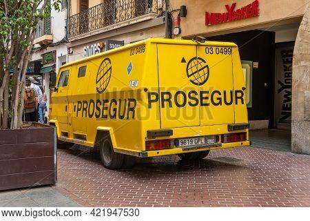 Palma De Mallorca, Spain; May 19 2021: Yellow Armored Money Transport Van Of The Company Prosegur Pa