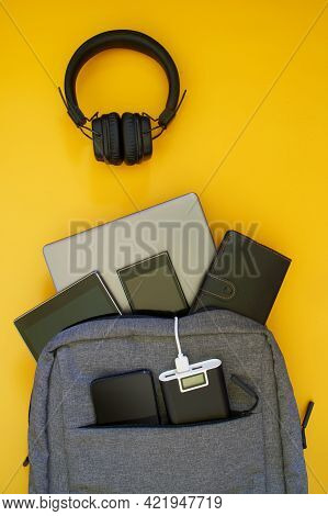 A Set Of Modern Gadgets: External Battery, Laptop, Tablet, Smartphones Are In A Fashionable Textile