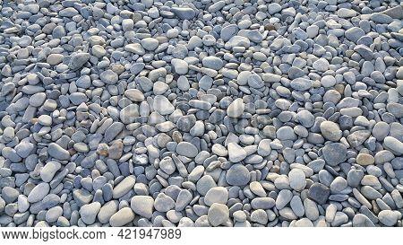 Stones Background. Sea Pebbles. Close-up Natural Texture.