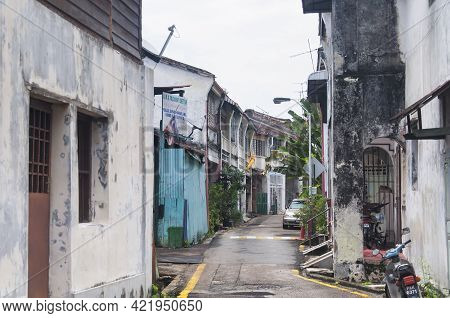 Penang, Malaysia.  August 19, 2017. Weathered Buildings Lining Narrow City Streets Within The George