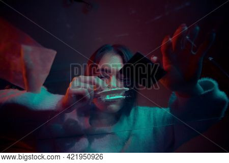Portrait Of A Girl Sniffing A Line Of White Drug Cocaine Powder. Addict And Addiction Concept.
