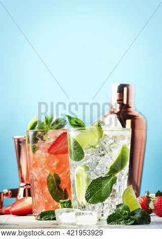 Summer Mojito Cocktail Or Mocktail Set With Lime, Mint, Strawberry And Ice In Glass On Blue Backgrou