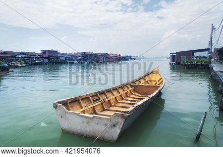 A Boat Tied To The Tan Jetty With The Historic Chew Jetty In The Background  Within The Historic Geo