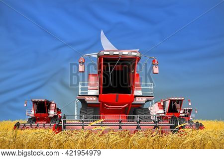 Four Bright Red Combine Harvesters On Rye Field With Flag Background, Somalia Agriculture Concept -