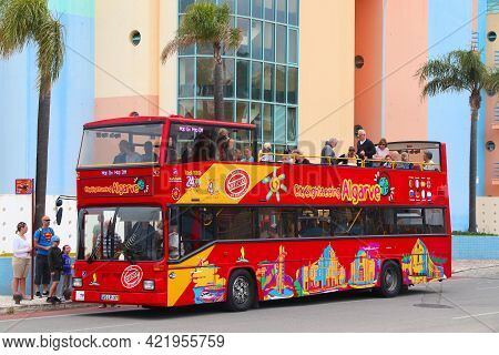 Albufeira, Portugal - May 30, 2018: People Ride A Sightseeing Double Decker Bus In Albufeira, Portug